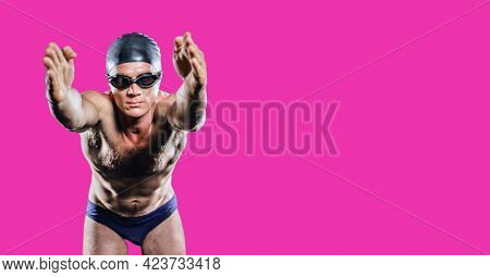 Composition of male swimmer with copy space isolated on pink background. sports and competition concept digitally generated image.