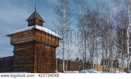 The Old Watch Tower Near The City Wall Was Built Of Natural Unpainted Logs. There Is A Spire On The