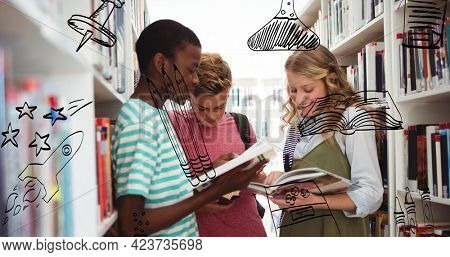 Composition of black doodle drawings over happy schoolchildren looking at books in library. school, education and study concept digitally generated image.