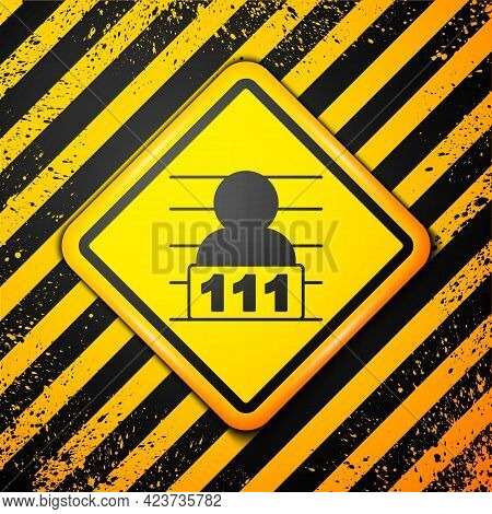 Black Suspect Criminal Icon Isolated On Yellow Background. The Criminal In Prison, Suspected Near Th