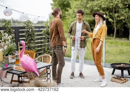 Young Adult Friends Hang Out, Talking And Having Fun Together At The Beautiful Backyard Of The Count