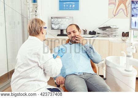 Sick Man Complaining About Tooth Pain Discussing With Stomatologist Senior Woman About Stomatology T
