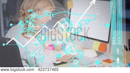 Data processing over world map against caucasian woman using computer at office. global business and technology concept