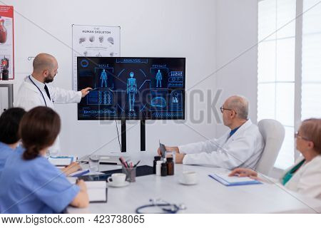 Physician Man Presenting Brain Radiography Analyzing Medical Expertise Working In Conference Meeting