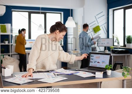 Businesswoman Analysing Financial Statistics Standing In Start Up Office. Executive Entrepreneur, Ma