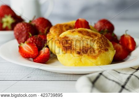 Cottage Cheese Pancakes Or Syrniki With Strawberry