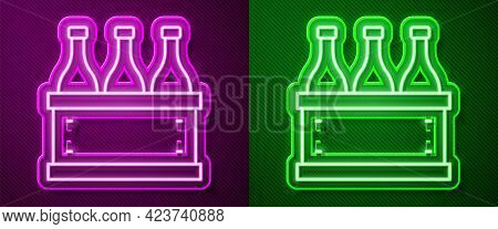 Glowing Neon Line Bottles Of Wine In A Wooden Box Icon Isolated On Purple And Green Background. Wine