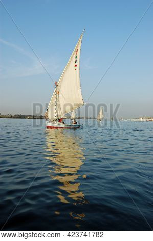 Luxor, Egypt - January 6, 2006: Tourists Enjoying A Relaxing Felucca Ride On The River Nile At Luxor