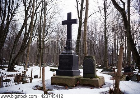 Grave With Black Cross In Snowy Cemetery With Leafless Trees - Smolenskoe Lutheran Cemetery, Russia,