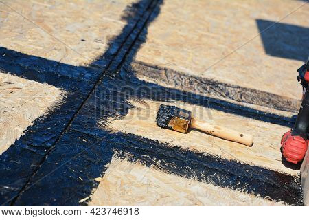 Roofing Construction And Underlayment: Applying A Hot Rubberized Asphalt, Bitumen To Seal The Roof S