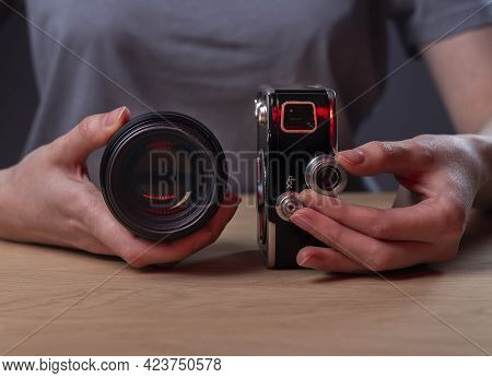 Photographer Showing Two Cameras, Vintage Old One And Modern Digital Lens, Closeup.