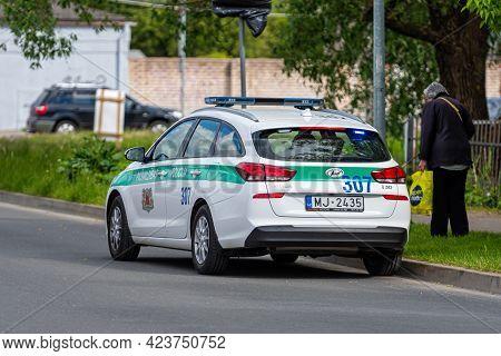 Riga, Latvia, June 01, 2021: Municipal Police (pasvaldibas Policija) Car Patrolling A City Street In