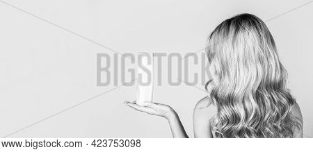 Girl With Shiny And Long Hair. Woman Long Hair. Woman Holding Shampoo Bottle. Beautiful Blonde Girl