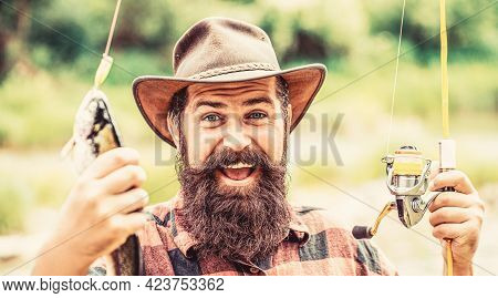 Fisherman And Trophy Trout. Man Holding A Trout Fish. Fishing. Angler With Fishing Trophy. Fisherman