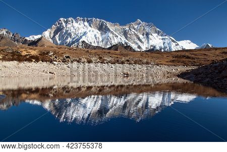 Panoramic View Of Lhotse And Nuptse South Rock Face Mirroring In Small Lake, Everest Area, Sagarmath