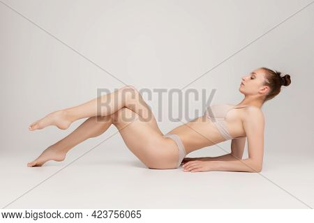 Perfect Slim Toned Young Body Of The Girl Or Fit Woman At Studio. The Fitness, Diet, Sports, Plastic