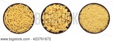 Collection Of Various Raw Pasta In A Bowl Isolated On White Background. Uncooked Fusilli, Vermicelli