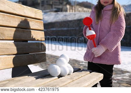 Little Girl Playing With Snowball Maker Outdoors, Closeup