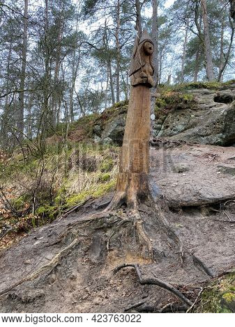 Wooden Sculpture of a fairy at the edge of the fairy path in Virton, Luxembourg, Belgium