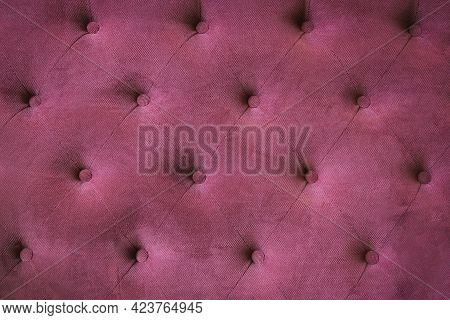 Fabric Upholstery On The Back Of A Vintage Sofa. Burgundy Red Background Color