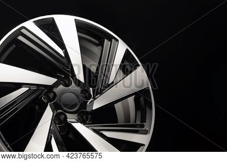 New Beautiful Alloy Wheel, Black With Polishing, Fragment Of Modern Technological Design