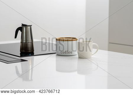 Brewing Coffee For Breakfast In Steel Pot On Built In Induction Ceramic Cooktop, White Labeled Jar C