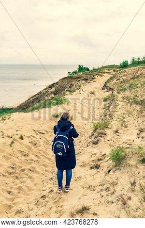 Nida, Lithuania - May 23 2021: Girl Visiting Sand Dunes In Nida, Klaipeda, Lithuania, Europe. Curoni