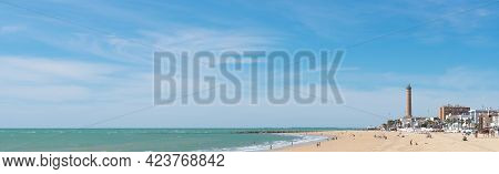 Chipiona Beach With The Lighthouse In The Background (the Highest In Spain And The Fifth In The Worl