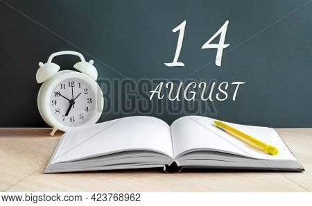 August 14. 14-th Day Of The Month, Calendar Date.a White Alarm Clock, An Open Notebook With Blank Pa