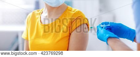 Nurse Giving Vaccine Syringe Against Covid 19 To Patient.