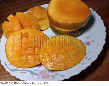 Sliced Mango With Knife On Plate