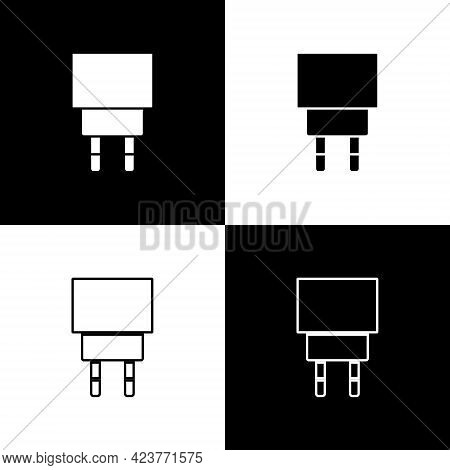 Set Charger Icon Isolated On Black And White Background. Vector