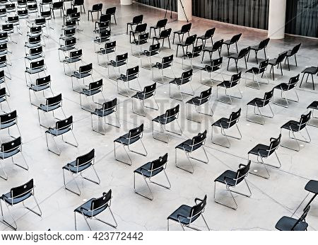 Many Black Chairs Standing Indoors At The Same Distance Before The Event