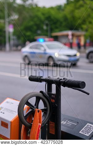 Electric Scooter Rental Service And Police Car Rental - Moscow, Russia, July 10, 2021