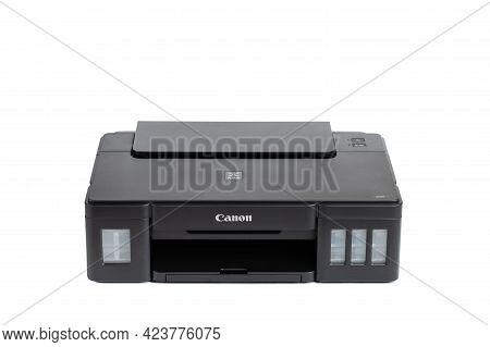 Kolomna, Moscow Region, Russia - 08 August, 2020: Canon Pixma G1411 Lnkjet Printer Isolated On White