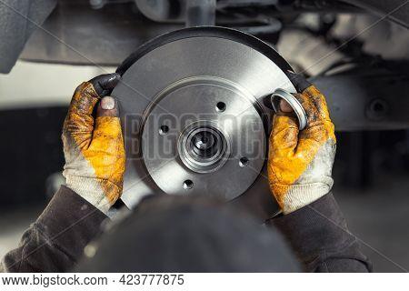 Closeup Male Tehnician Mechanic Greasy Hands In Gloves Install New Car Oem Brake Steel Rotor Disk Du