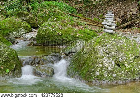 Rock Stack, Next To A Wild Stream. Pile Of Stacked Rocks, Balancing On A Big Rock In A Streambed. Ro