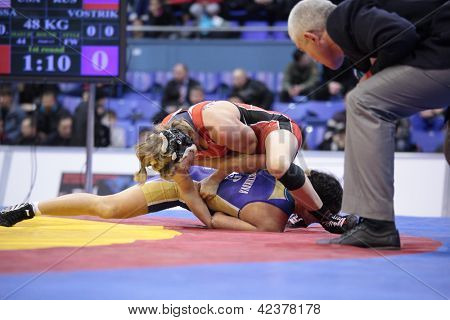 KIEV, UKRAINE - FEBRUARY 16: Final match between Lampe, USA, red and Vostrikova, Russia during International freestyle wrestling and female wrestling tournament in Kiev, Ukraine on February 16, 2013