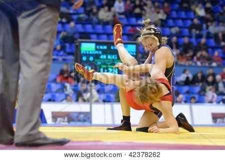 KIEV, UKRAINE - FEBRUARY 16: Match between Lampe, USA, blue and Pulkovska, Ukraine during XIX International freestyle wrestling and female wrestling tournament in Kiev, Ukraine on February 16, 2013