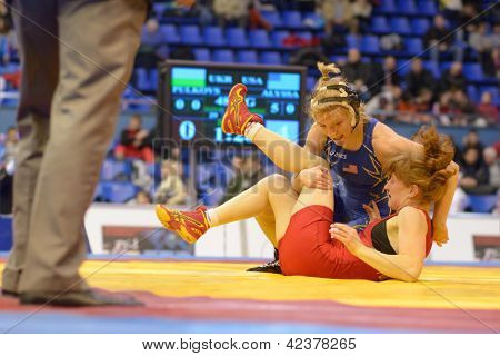 KIEV, UKRAINE - FEBRUARY 16: Match between Lampe, USA, blue and Pulkovska, Ukraine during XIX International freestyle wrestling and female wrestling tournament in Kiev, Ukraine on February 16, 2013