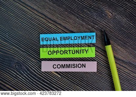 Equal Employment Opportunity Commision Write On Sticky Notes Isolated On Wooden Table.