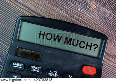 How Much Write On Calculator Isolated On Wooden Table.