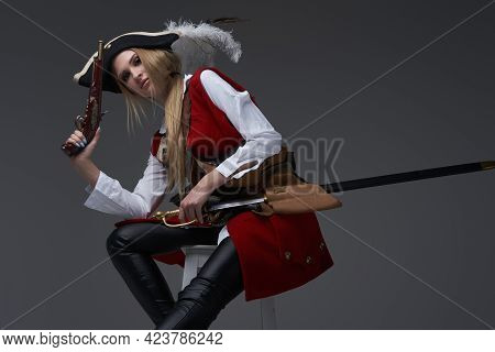 Attractive Woman Corsair With Handgun And Saber