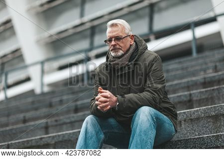 Prayer To God. An Elderly Man Sits Outdoors Hoping. Thinks Alone, Depressed.