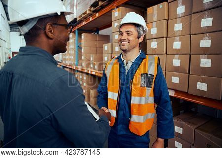Happy Technicians Greeting Each Others At Industrial Storehouse