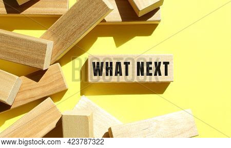 What Next Text Written On A Wooden Blocks On A Yellow Background. Business Concept