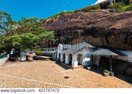 Rock cave ancient Dambulla Cave Temple ka Golden Temple of Dambulla in Dambulla, Sri Lanka - important Buddhist religious pilgrimage site and tourist destination