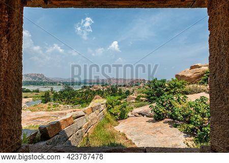 Ancient Vijayanagara Empire civilization ruins of Hampi now famous tourist attraction. Sule Bazaar, Hampi, Karnataka, India