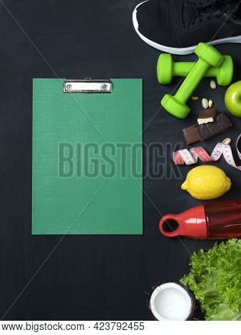 Top View Of An Athletic Sports Set With A Clipboard Folder With A Metal Clip And Sports Items Such A