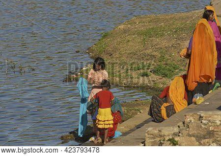 Pushkar, Rajasthan, India - November 4, 2008: Group Of Females Bathing In The Sacred Pushkar Lake Th